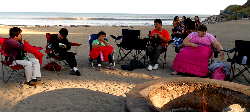 Roasted hot dogs, smores, and live music during the annual bpnfire at Cabrillo Beach
