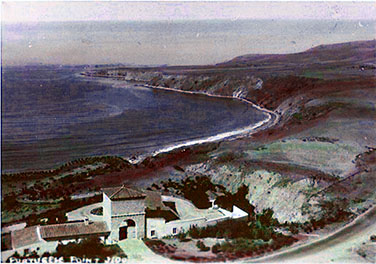 View of the Harden Estate Gatehouse in the 1930s with the landscape, shoreline, and water