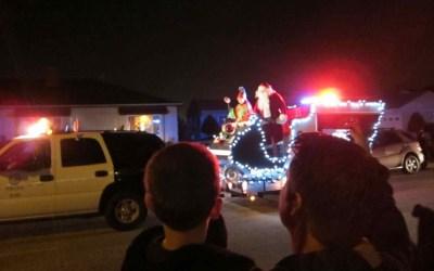 Santa with police escort (400x250).jpg